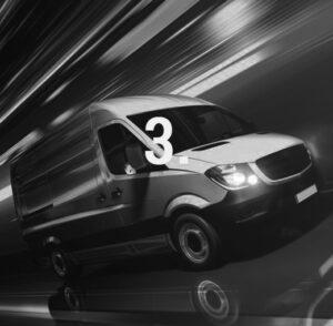 Ein weisser Sprinter fährt schnell vorbei. Im Vordergrund steht 3.